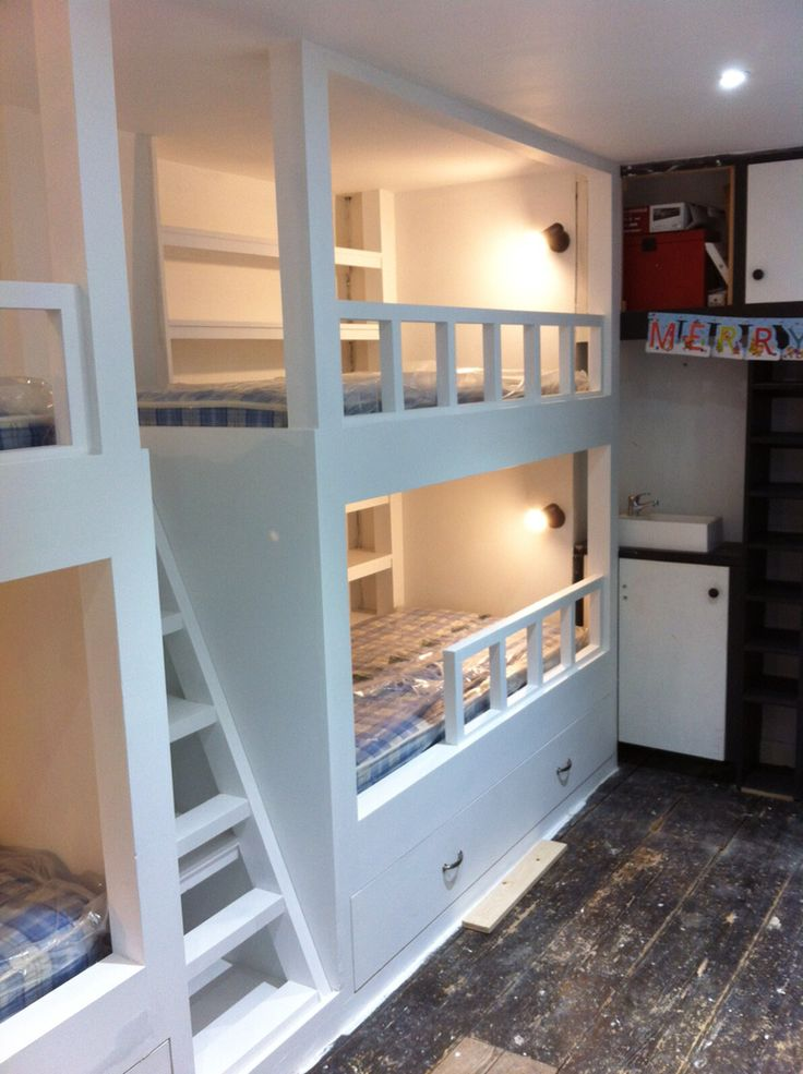 Children's double bunk beds with trundle beds and shelving