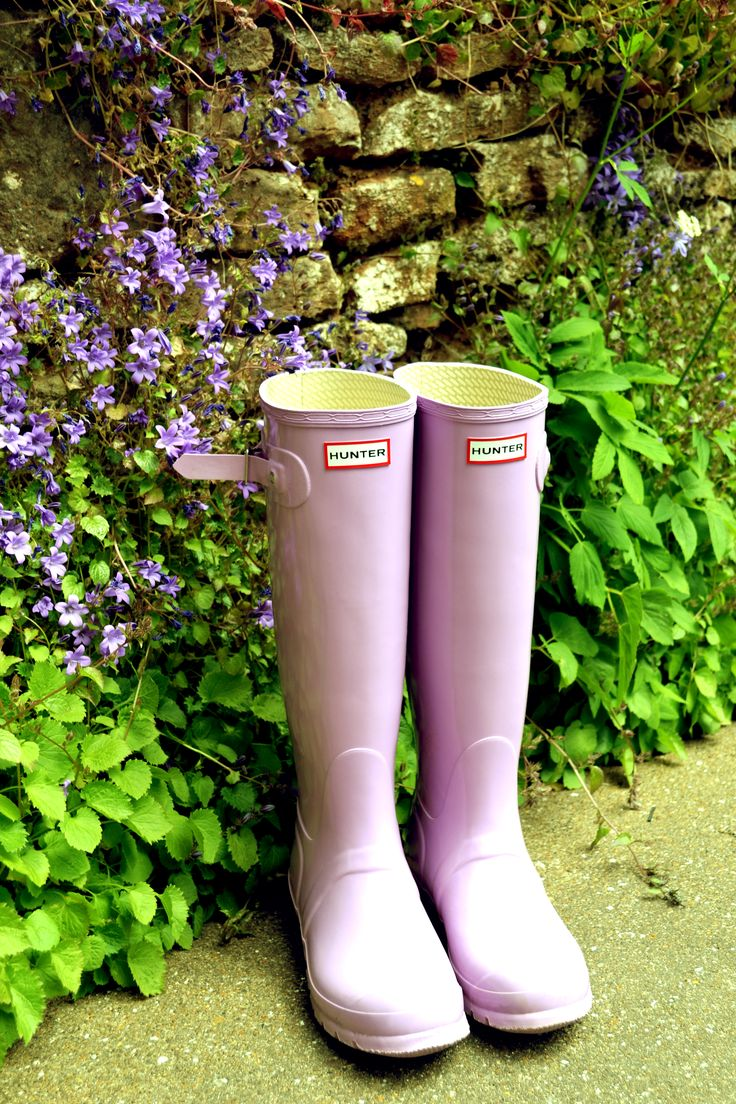 Love the contrast between the bright, green plant leaves and the pale, lilac purple Hunter rain boots