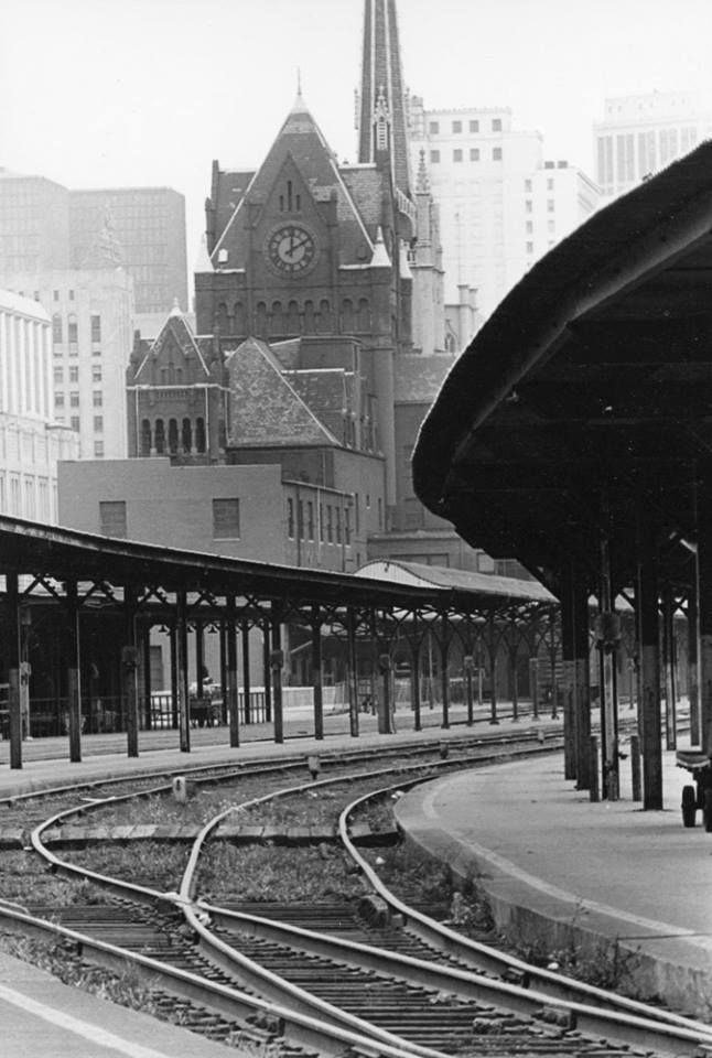 """A view of the Union Depot Train Station on the corner of Third and Fort Street, ten days after the last train left and the station was closed, Detroit, Michigan. The Romanesque Revival structure was built of red sandstone between 1891 - 1893 by James Stewart & Co. and was demolished in January of 1974. * Photographer's Note: """"The tracks that led into the station that looked like a castle. A marvelous building that many old Detroiters will always remember."""" (photo via Detroiturbex.com)"""