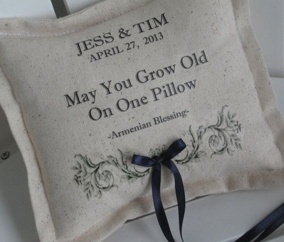 Charming French Vintage ring pillow is personalized with your names, date and cherished words. Pillow in photo displays the traditional Armenian Blessing. Feel free to add your own meaningful poem, prayer, bible verse or song lyrics.  Printed on a cotton / linen blend, this ring pillow is constructed with an elegant flange border and has a small back pocket / envelope opening and a separate pillow insert. Ribbon in the color of your choice (or twine) is securely stitched to the center of a…