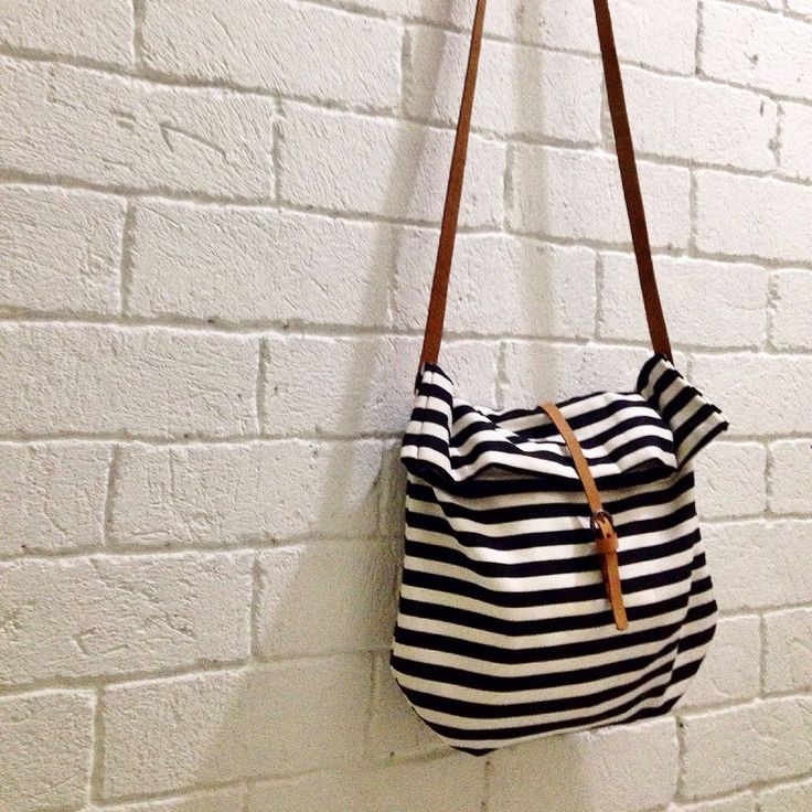 Stripe canvas sling bag with leather Strap.