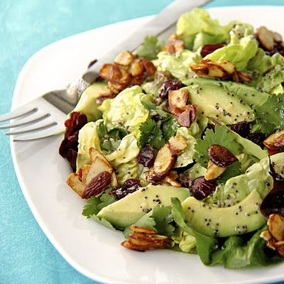 Cranberry avocado salad with candied almonds and white balsamic vinaigrette!