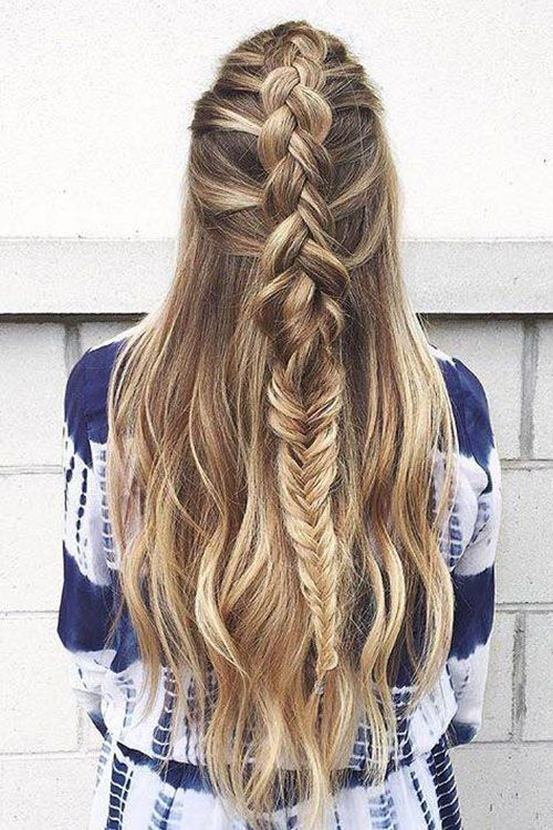 Long hair + braids = perfection. We're loving this mixed dutch and fishtail braid by @Bow and Arrow Hair Lounge.
