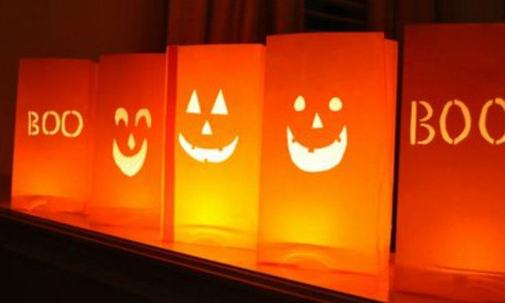 Paper Bag Jack-O-Lanterns: Looking for a Halloween craft idea that's extremely affordable? Kids can go wild making as many jack-o-lanterns as they want when they're just cutting faces in orange paper bags and lighting them with battery-operated tea lights.