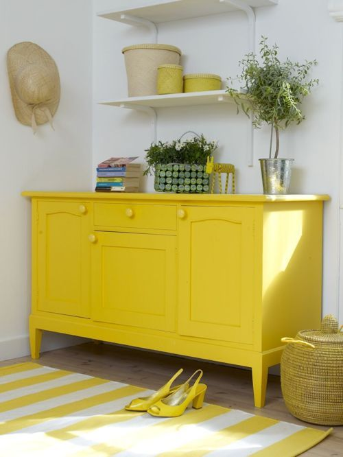 yellow painted cupboard