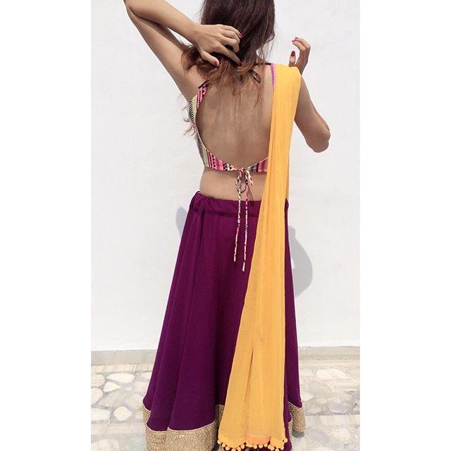 People will stare. Make it worth their while. 💎 Mandatory back picture. 💁🏻 . #navratri #chaniyacholi #purple #aztec #yellow #back #candid #perksofbeingamodel #unitedway #vadodara #nothot #onlygraceful #model #modellife #lights #camera #pose #iger #instagram