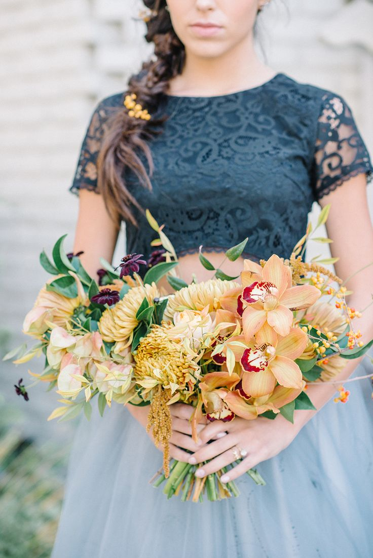 yellow bouquet - photo by Krista Mason Photography http://ruffledblog.com/unconventional-wedding-inspiration-with-grey-and-marigold