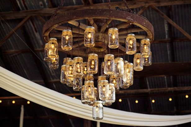 Mason jars chandelier. Really adds to a rustic decor!  Can use wire for candle holder and embellish w/ beads etc