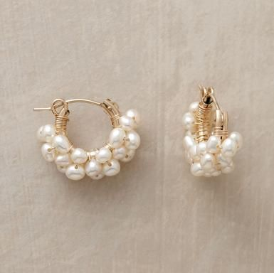 """Froth Of Pearls Hoops  Little cultured pearls envelop 14kt goldfill hoops in a luminous froth. The gems are wired by hand; the earrings finished with snap down wires. Made in USA. 5/8""""L."""