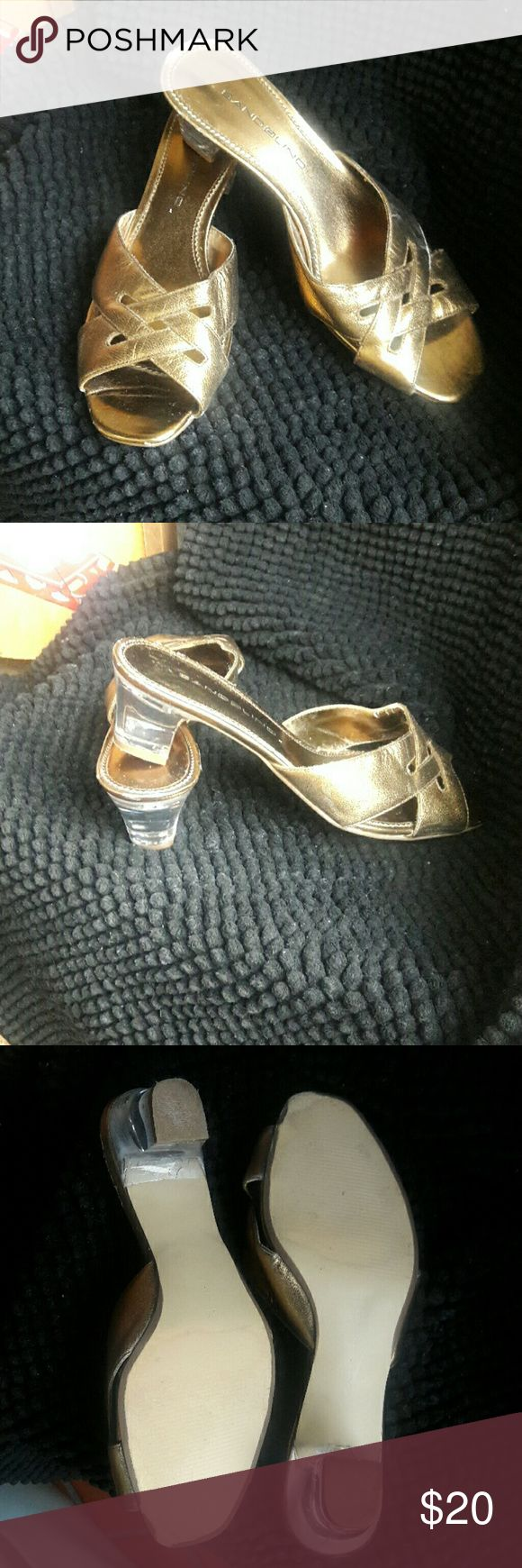 """Bandolino Gold Glass Heel 2""""Heel Mules Sandals Brand Bandolino  Style #0108 DBBSafe Size 6M Gold Metallic  Large Weave Cross Strap with 2""""heel in Glass (Clear). Leather Upper Balance Manmade Good Condition no noticeable outer flaws inside has slight cracking and bottom soles do show wear.  Could dance all night in these shoes. Bundles available with discounts Bandolino Shoes Mules & Clogs"""