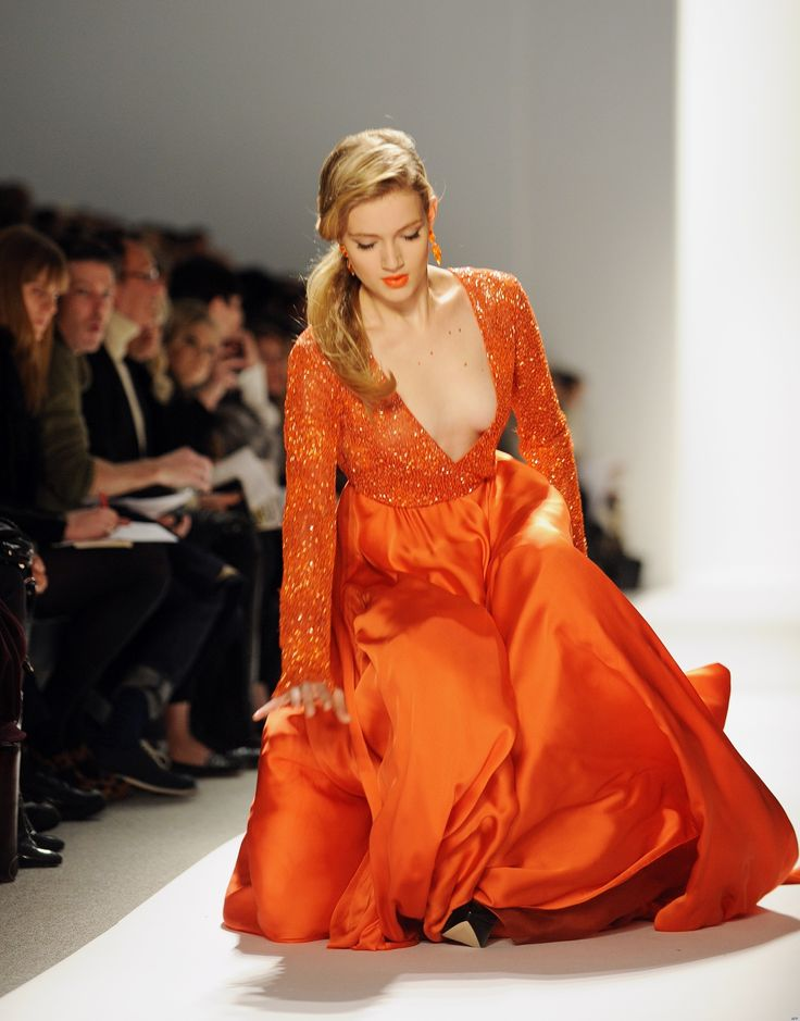 -Incredibly beautiful woman wearing the best hue orange - ever!  -Even in falling, she is the epitome of grace. -Wow.