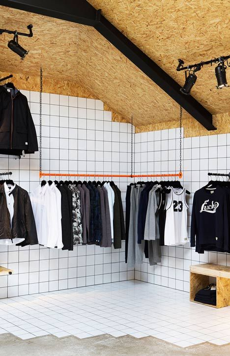 Two very basic materials come together - white tile and plywood - to create an experience \\\ SUIT Store Reykjavík by HAF Studio