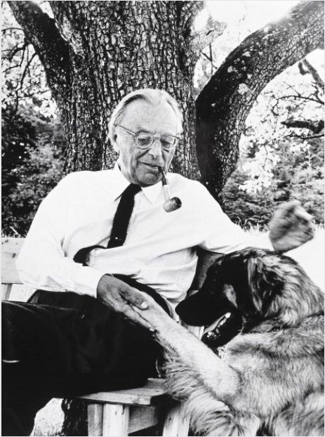 Carl Orff playing with his dog. He is the composer who did Carmina Burana