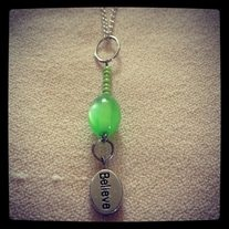 "Shiny lime green bead, with a dangling silver ""Believe"" charm. Situated on a light, silver chain, with screw-type closure.    Lime green awareness ribbons pertain to:    Duchenne Muscular Dystrophy  Ivemark Syndrome  Lyme Disease  Lymphoma  Mental Health  Muscular Dystrophy  Non-Hodgkins Lymphoma  Sandhoff Disease  Support for Adoptees Rights to Open Adoption Records that have been Sealed"