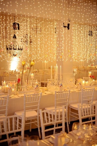 Gold lighting on white decor.  Venue: MolenVliet Wine and Guest Estate.  Event: Planner: Aleit Group.  Florist: Okasie, Stellenbosch, South Africa.  Wedding Style: Real Weddings.