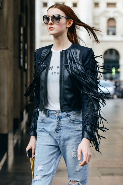Shop this look on Lookastic:  https://lookastic.com/women/looks/black-jacket-white-and-black-crew-neck-t-shirt-light-blue-boyfriend-jeans-black-sunglasses/12994  — Black Sunglasses  — White and Black Print Crew-neck T-shirt  — Black Fringe Leather Jacket  — Light Blue Ripped Boyfriend Jeans