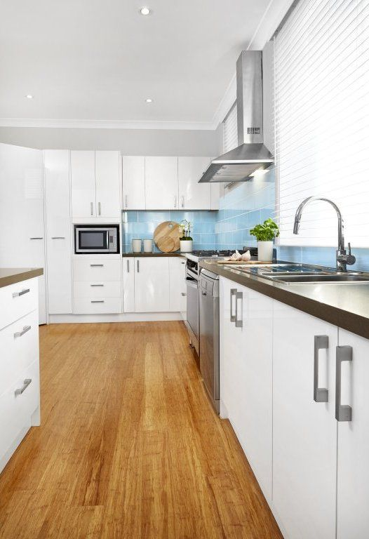 Masters Kitchens - Bring a touch of luxury to your kitchen with the range of white-gloss Mission Beach doors and drawers.