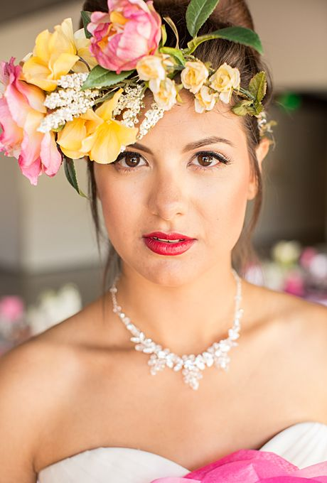 Brides: The Prettiest Wedding Hairstyles with Flower Crowns  A Vibrant Pink and Yellow Flower Crown   Photo by Huong Forrest