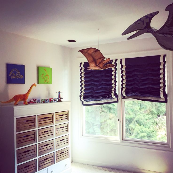 Hanging dinosaurs from ceiling