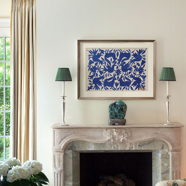 Beautiful blue Tenango embroidery from Otomí artisans over an elegant mantle on St. Frank