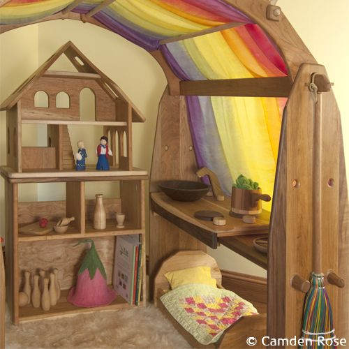 The playroom is transformed into a magical place with our handcrafted Waldorf wooden play stands. Choose cherry or maple with walnut accents and add a silk canopy, and additional shelves as your child grows.