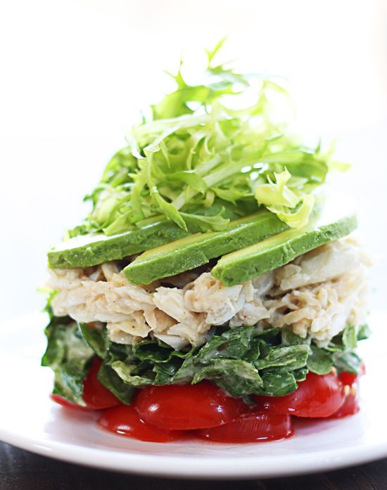Chicken Salad stack. Really it's all about presentation and adding the dressing on the lettuce before stacking....cherry tomatoes, romaine lettuce chicken/egg salad , avacado slices topped with a little spring salad mix.....