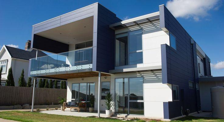 Modern Mixed Material Facade Double Storey Home.