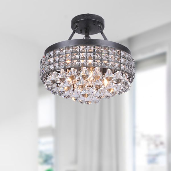 Incorporate some vintage elegance into a room with the antique bronze finish on this semi-flush mount chandelier. Its four-light fixture provides ample light to an entire room, and the clear crystal p