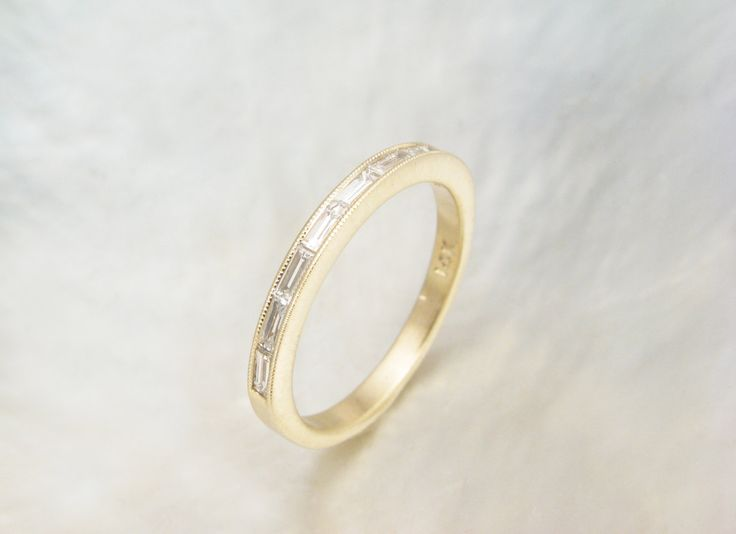 dainty baguette diamond ring, channel set -- baguette diamond wedding band with milgrain by RavensRefuge on Etsy https://www.etsy.com/listing/168886990/dainty-baguette-diamond-ring-channel-set