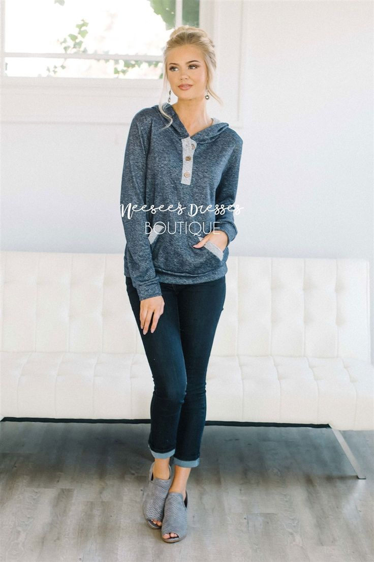 Comfortable, perfect for fall and so soft! Navy hoodie features a front pocket and cute button details on the neck.
