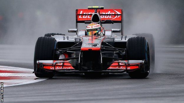 Lewis Hamilton sets pace in practice at soaking wet Silverstone F1 Grand Prix 2012