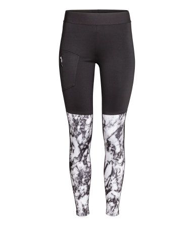 H&M Outdoor tights in fast-drying, functional fabric with wide elastication at waist. Key pocket at back with zip, leg pocket with zip, and zips at hems. Brushed, thermal inside. Size of leg pocket 3 x 6 in.