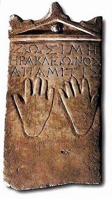 "Gravestone for ""Zosime, daughter of Herakleon"", from Syria, late 1st century B.C. The hands on the stele symbolize her relatives' vow to avenge her death which was apparently not a natural one."