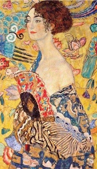 'Lady with a Fan' by Gustav Klimt is a half-portrait with an awesome background of asiatic ornaments. She wears a kimono style dress  imprinted with motives of a Chinese dragon dress. (1917)