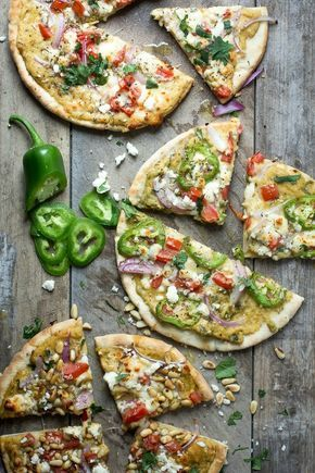 Hummus on flatbread pizza=groundbreaking. Get the recipe at Foodness Gracious.   - Delish.com