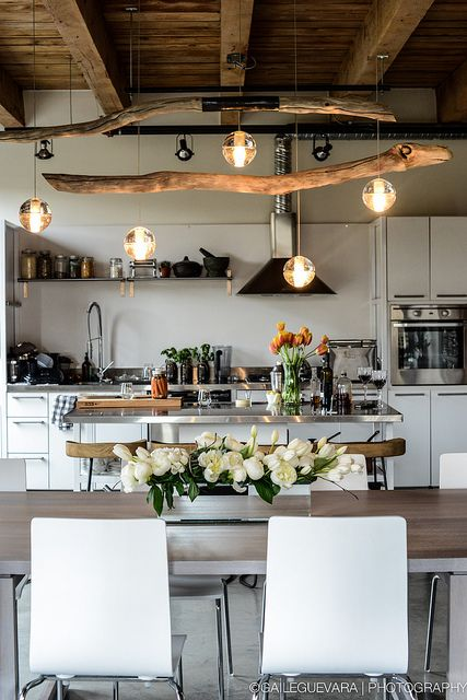 Love this kitchen and dining room open space. The light feature is a perfect balance of timber and industrial lighting.: