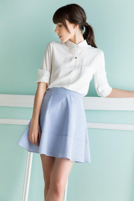 Seersucker is a classic spring & summer textile. The Kensington Seersucker Skirt features a blue & white seersucker fashioned in an a-line silhouette.