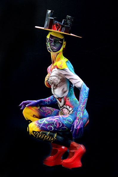 A participant poses with her body paintings designed by bodypainting artist…