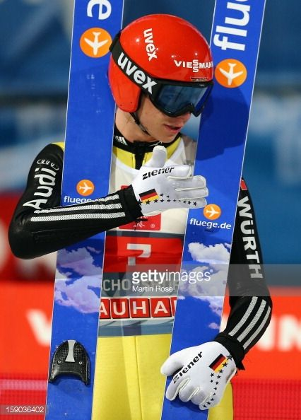 Andreas Wellinger of Germany reacts during the final round of the FIS Ski Jumping World Cup event at the 61st Four Hills ski jumping tournament at...