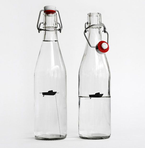 Bottle with a floating boat inside