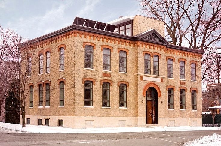 Schoolhouse Reborn by Sullivan, Goulette & Wilson. An 1880's brick schoolhouse located in Chicago was converted into a home for a family of seven.