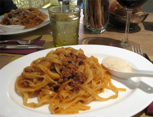 My very first authentic spaghetti bolognese in a Modena caffè - love the use of a Chinese spoon for the grated cheese.