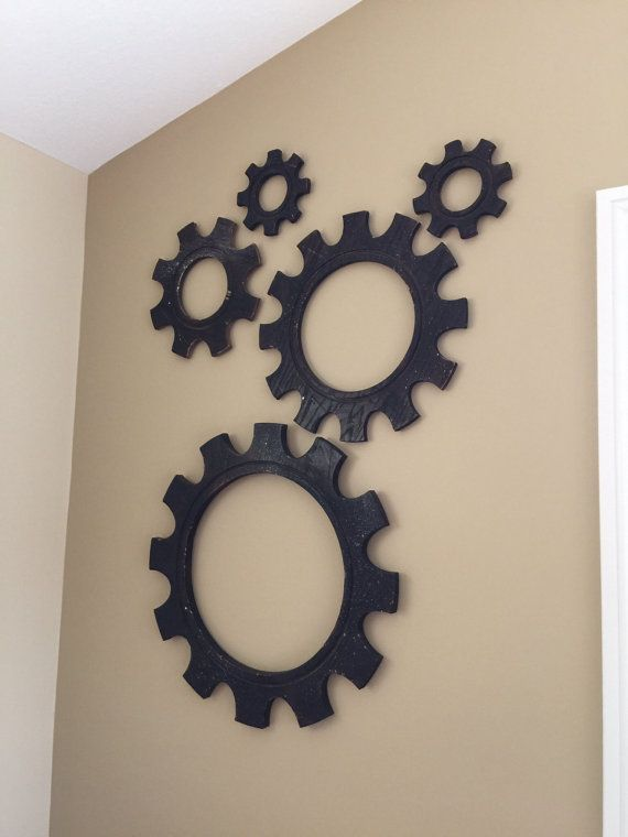 Made of wood, this set of Gears is sure to make a great statement in your home or office. Industrial is in and what better way to salute industrial art