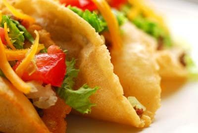 Puffy tacos   Homesick Texan---- the taco meat is amazing.  I will (if budget/time applies) NEVER EVER use my trusty ol' Taco Bell seasoning again!!! In my time crunch I didn't get to make the shells so I just fried some soft tortilla shells in oil. :-/. Still turned out amazing