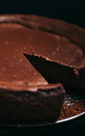 A moist, dense, flourless chocolate cheesecake made with Guinness Extra Stout and lots of love! Perfect for a St. Patrick's Day dessert!