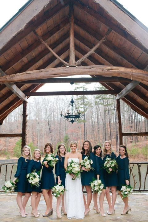 Long-sleeved bridesmaids' gowns are not only one of the hot trends of this year but also a good idea for fall and winter weddings.