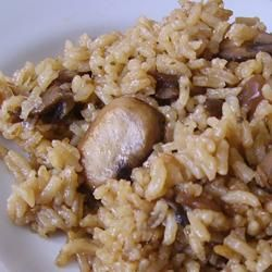 We call this Grandma rice in our house, because (originally enough) it was my Grandma's recipe.  I leave the mushrooms out because no one in my house likes them.  But, with or without, it's unbelievable.