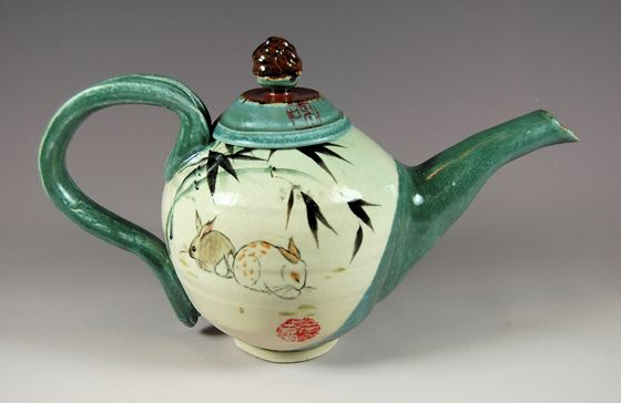 Bunny bamboo teapot set... Seafoam green teapot with bamboo representing resilience and longevity is detailed with a double happiness chop and iron red interior. Two matching cups included with set. Available for purchase at Scope Gallery, Torpedo Factory, Alexandria, Va.