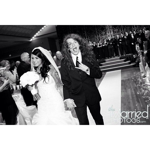 Of course I threw up the horns on my wedding day  Photo by levi_benton #MMI lol love Levi
