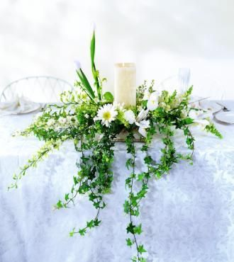 White blossoms and ivy greens set the stage for this candle design with a contemporary flair. White Iris are companions to viburnum, larkspur, snapdragons and more.